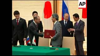 (12 May 2009) SHOTLIST 1. Wide of Russian Prime Minister Vladimir Putin and Japanese Prime Minister Taro Aso walking into ...