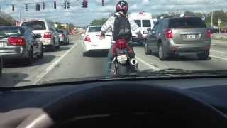 Guy On Motorcycle Popping Locking And Dropping It, At A Stop Light
