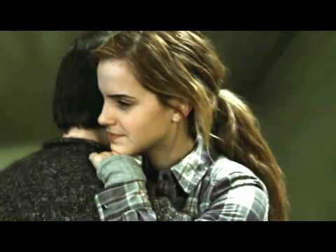 Harry dances with Hermione.