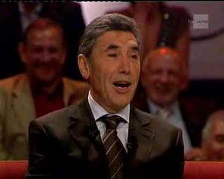 Le baron Edouard Louis Joseph Merckx (Eddy Merckx) nous récite le Corbeau et le Renard en Brusseleir