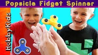 We show how to make popsicle fidget spinners that spin! Homemade healthy sweet treat. This idea created by HobbyMom of HobbyKidsTV. Subscribe for NEW Shows: http://www.youtube.com/subscription_center?add_user=HobbyKidsTV ---TOY VIDEOS---Family Video Gaming Fun: https://www.youtube.com/playlist?list=PLzDMAGLsSlZrhbIdcXn1B5qLtd_6D9407World's Biggest Surprise Eggs: https://www.youtube.com/playlist?list=PLzDMAGLsSlZoNvpGg-ijs4DlYu2RMSOxoGames and Challenges: https://www.youtube.com/playlist?list=PLzDMAGLsSlZqo_IVVsyn7Sn0yFehplgK1Best Family Fun Shows: https://www.youtube.com/playlist?list=PLzDMAGLsSlZpBsqsE4zkBbucAsQ0bgiWdLearning Playlist:http://www.youtube.com/playlist?list=PLzDMAGLsSlZo8aAHrPRzVmM_oW_hZtxdO---OUR OTHER HOBBY CHANNELS---HobbyFamilyTV (Vlog and Extras): http://www.youtube.com/user/hobbykidsvidsHobbyPigTV (Video Gaming):http://www.youtube.com/user/hobbygamestvHobbyFrogTV (Video Gaming):http://www.youtube.com/user/hobbytrixieHobbyBearTV (Toys, Video Games, more):http://www.youtube.com/user/hobbykidsland---FIND US---http://www.Twitter.com/HobbyKidsTVhttps://www.facebook.com/HobbyKidsTV/http://www.HobbyKidsTV.comhttps://www.instagram.com/hobbykidstv/---ABOUT HobbyKidsTV---HobbyKidsTV is the #1 place for kids to watch family-friendly clean shows! Video gaming and giant surprise egg adventures. We are world renowned for being the first and original inventor of all GIANT SURPRISE EGGS! It was our sons unique idea in 2013 to make a wonderful GIANT surprise egg for all our fans. We are the leader in kids creative ideas, skits and science fun. Subscribe to HobbyKidsTV, the trusted brand of families across the globe. We produce the best and most fun kids toy and gaming shows. Collector of the best toys to teach kids imaginative play through games or adventures. HobbyKids love sharing fun educational learning and popular play. Be a HobbyFan today and subscribe for free to see new edutainment shows!---MUSIC BY---Epidemic Soundfun under the sun 14tropical suntan 2