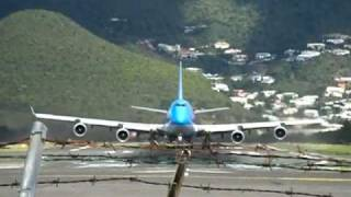 A Boeing 747-400 operated by Corsair departing St. Maarten right over my head. Watch the rear wheels leave the runway right at...