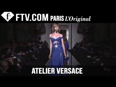 Fashion TV - http://www.FashionTV.com/live PARIS - Atelier Versace is back at Paris Couture Fashion Week with a very sexy collection for Spring/Summer 2015. Swirling cutouts in bold colors become progressively.