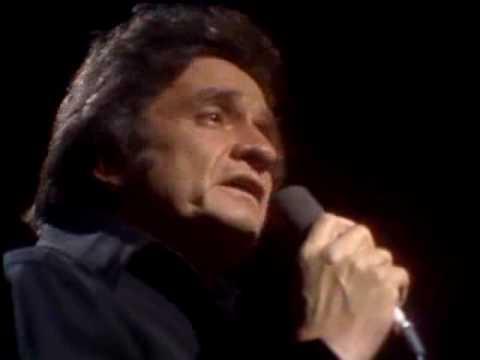 Tekst piosenki Johnny Cash - The Fourth Man in the Fire po polsku
