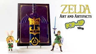 Hey guys, here is a video with some pop-up Zelda fun facts to enjoy while getting an inside look at the Legend of Zelda: Art and Artifacts Delux Edition hardcover Book. Hope you enjoy :) Product Description -As with the standard edition of The Legend of ZeldaTM: Art & Artifacts, this amazing book contains artwork from the entire history of the video game franchise, including the upcoming The Legend of ZeldaTM: Breath of the Wild, this is the sequel hardcover to Dark Horse's 2013 bestseller, The Legend of ZeldaTM: Hyrule Historia. It includes rare promotional pieces, game box art, instruction booklet illustrations, official character illustrations, sprite art, interviews with the artists, and much, much more! This exclusive edition of only 10,000 copies features an original cover with a raised 3D embossed https://www.amazon.com/Legend-Zelda-Artifacts-Hardcover-February/dp/B06WVDWDCT/ref=pd_sbs_14_img_2?_encoding=UTF8&psc=1&refRID=8AK10F8ERR93XFH635S1Music by: https://soundcloud.com/cleffernotes