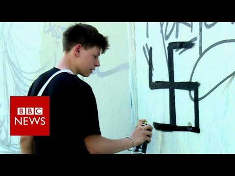 Berlin Street Artists creatively get rid of Swastika graffiti.
