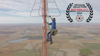Check out our Facebook page: http://www.facebook.com/prairieaerialTo use this video in a commercial player, advertising or in broadcasts, please email Viral Spiral: contact@viralspiralgroup.com Somebody has to change out that lightbulb at the top of those tall TV towers!This is tower climber Kevin Schmidt making the climb to the very top of the now inactive KDLT TV analog broadcast antenna near Salem, SD.It was a beautiful fall day for a climb and the views are stunning! I would suggest watching at 1080 HD in full screen to get a small taste of the experience.