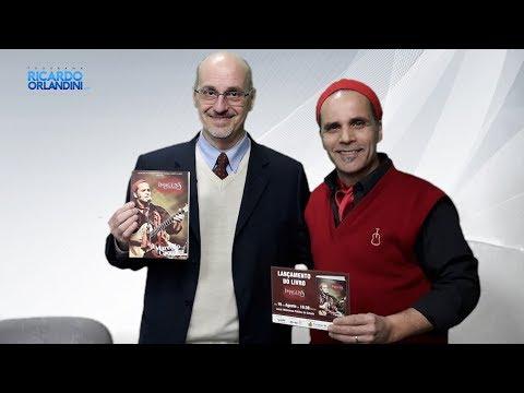Ricardo Orlandini entrevista o violonista, cantor e compositor, Marcello Caminha, apresentando seu livro 'Imagens Song Book'.