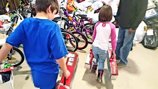 Kids Donating New Christmas Toys To Less Fortunate Kids This Holiday Season