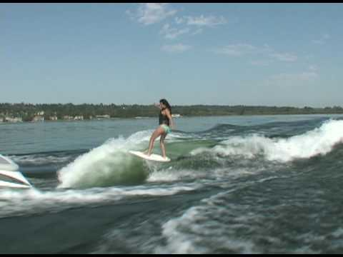 Rayne riding behind a Centurion on Inland Surfer Infectious board