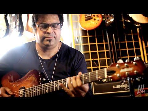 Rez Abbasi & Tuxedo baritonová kytara