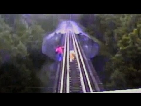 bridge - Two women narrowly escaped being killed when a train surprised them as they were walking along railway tracks on a bridge in Indiana Footage has been released of a terrifying incident where...