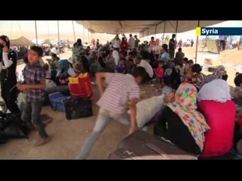 Syrian Kurds continue to flee jihadi violence: refugees flooding into neighbouring Iraqi Kurdistan