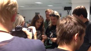 "Steve Harris & Nicko McBrain signing 30 years old wedding photos. The blond lady on the left is the bride from the famous ""Iron ..."