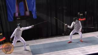 This is the gold medal bout in the men's foil event at the NCAA fencing championships in Indianapolis, Indiana. Andras Nemeth of St. Johns University is on the right and Nolen Scruggs of Columbia University is on the left.