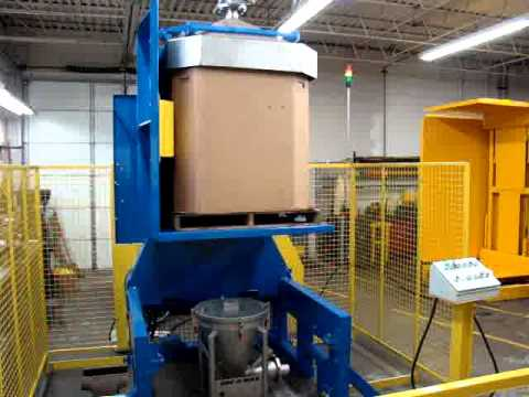 Cherry's box dumper for dumping bulk materials from a gaylord container.