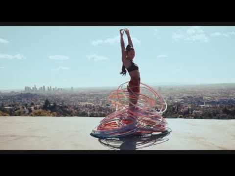Woman Successfully Hula Hooping 180 Hoops