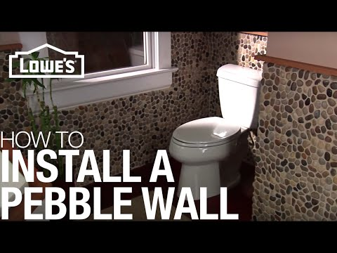 tiles - After prepping for a Pebble Tile Accent Wall, you will want to begin to apply the tile. For this project you will need scissors to cut the tile mesh, a premi...
