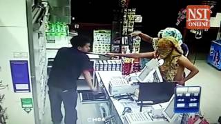 Da Hinggan Ling China  city photos gallery : Manhunt on for makeshift sarong-masked convenience store robbers, CCTV footage gone viral