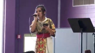 Hmong girl singing at Appleton East High School