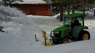 8. John Deere 3039R Snowblowing