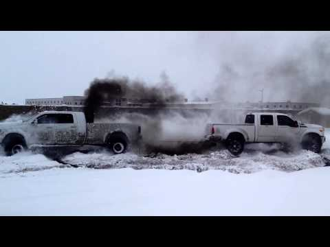 1200 horsepower donuts in the snow with Ford, GMC and Dodge