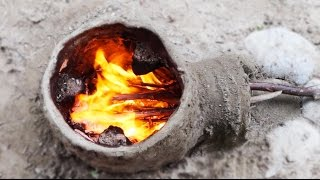 """In this video I show how I made a primitive rocket stove using clay, sand, sticks, a few pebbles and some water and then cooked on it.Music by: Blue Dot Sessions: http://freemusicarchive.org/music/Blue_Dot_Sessions/Plaster/LatheandScott Holmes: http://freemusicarchive.org/music/Scott_Holmes/Film__Documentary/Monther_Nature_1569Recipe in video: """"Sweet stew"""": an orange, a few pealed apples, some walnuts, almonds,, dates and figues all cooked in a little water."""
