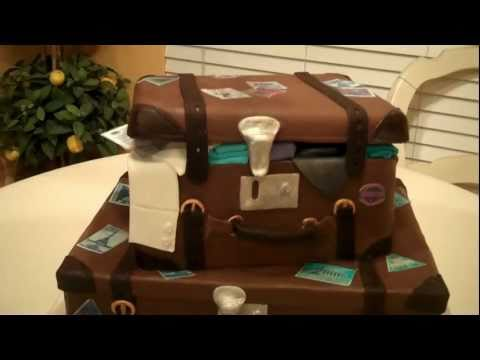 fondant suitcase cake - Chocolate and White cake frosted with Chocolate Ganache and covered in chocolate fondant. Printed Luggage stickers on to frosting sheets. Tutorial for this w...