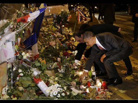 Shortly after arriving in Paris, US President Barack Obama visits the memorial at the Bataclan concert hall to pay tribute to the victims of the deadly Paris attacks.