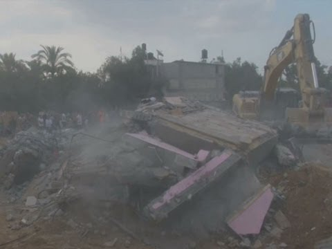 Family - Bulldozers and rescue crews were clearing rubble on Monday from a building in southern Gaza that was hit by an Israeli airstrike on Sunday evening, killing 25 members of the same family, according...