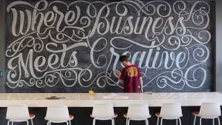 Professional hand letterer time-lapse video of chalk art on 200 sq. ft. chalkboard at Tempe, AZ Advertising Agency, Zion & Zion.