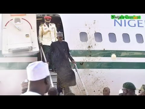 Frail Buhari Nearly Blown Away By Wind on Return From UK Medical Sick Trip