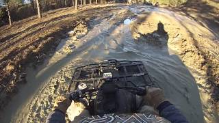 4. Arctic Cat 400 4x4 TBX in the mud