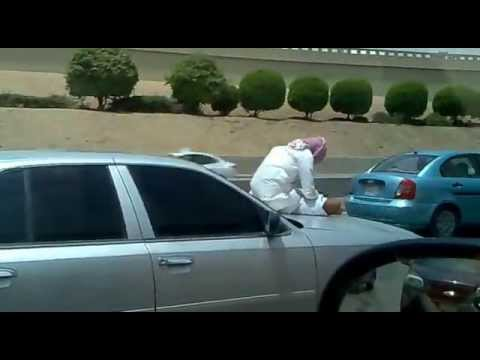 Video:  Saudi Man Texting While Riding on the Hood of a Car.