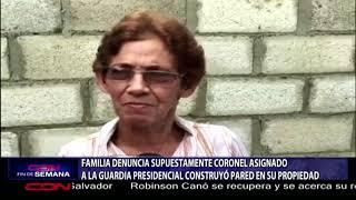 Familia denuncia supuestamente CORONEL asignado a la GUARDIA PRESIDENCIAL construyó pared en su propiedad