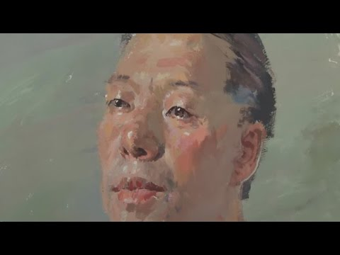 Painting the Portrait of Man in Gouache