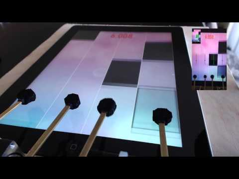 Guy Builds Robot To Beat Piano Playing Game On
