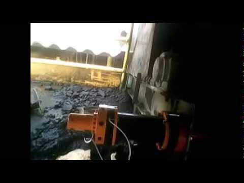 SISTEMA DE RASPADOR AUTOMÁTICO PARA ESTEIRA
