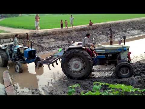 Tractorpulling - A tractor got stuuck in a canal due to hairo, Tractor 2 comes for rescue.