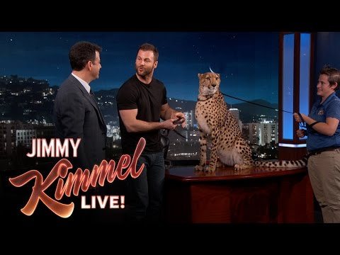 Jimmy Kimmel looks real comfortable with these animals