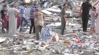 Footage shows Israeli air strikes on two Gaza City tower blocks which caused one building to collapse and severely damaged the other. Tuesday's strikes levelled the 15-storey Basha Tower containing apartments and offices and severely damaged the Italian Complex. A resident from the Italian tower tells of a brief phone call from the Israeli army ahead of the strike