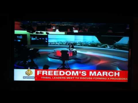 Gaddafi Gaffe -- Aljazeera English Anchor has a Freudian slip? Blooper?