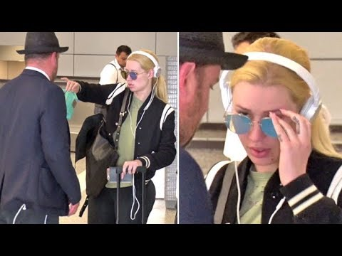 SO GENEROUS Iggy Azalea Gives Her LAX Airport Handler A Gift Upon Arrival From Budapest