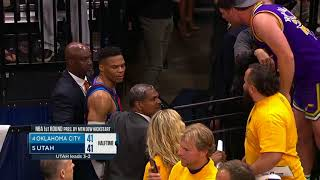 Russell Westbrook gets into it with Jazz fan coming off the floor for halftime