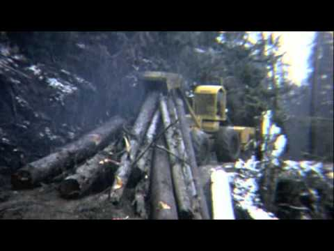 Log Skidder in snow & mud
