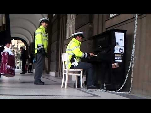Policeman playing on a street piano in Prague