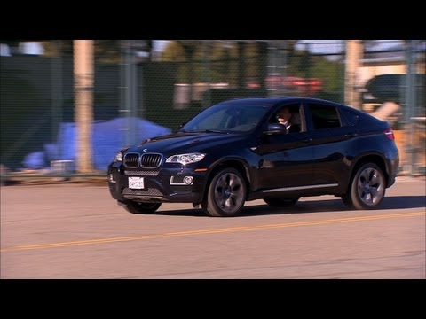 x6 - http://cnet.co/Z4dsCL The 2013 BMW X6 XDrive 35i is a mouthful to say and a big lumbering vehicle with some confusing technology inside.