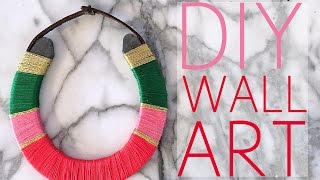"""Check out the super fun & easy wall art hanging from a horseshoe! Click here to find a Hallmark Signature Store near you: http://bit.ly/2g1bjrISUBSCRIBE -                   https://www.youtube.com/HeyMaryElizabethTWITTER -                       https://twitter.com/maryelizabethINSTAGRAM -                 https://instagram.com/heymaryelizabeth/SNAPCHAT -                   TotallyRadicalPINTEREST -                   https://www.pinterest.com/HeyMaryPins/WHAT I USED:E6000 Glue:  http://rstyle.me/~9k2CYEmbroidery Thread:  You can buy a pack or individually at any craft store too! Gold -  http://rstyle.me/~9k2CYPink -  http://rstyle.me/~9k2CYGreen - http://rstyle.me/~9k2CYRed - http://rstyle.me/~9k2EQHorse Shoe:  http://bit.ly/2hofhMoI bought mine locally from a """"farrier"""" shop.  You can look that up or here are a few online. I chose to make mine from a Draft horseshoe, so it's extra big.  They're usually sold in pairs, so this is perfect if you want to make more than one.  Leather Strap:  I purchased mine at my local craft store for about $4.  Here is  something similar:  http://bit.ly/2gKoBpyWHAT I DID:I created a layout I liked and then started!  I began by securing the thread down with E6000 with my finger on the back of the horseshoe.  Then I wrapped around to cover the beginning for extra security.  When I was done, I secured with E600 & did the same with the next color.  I tried knots but the glue is the least conspicuous way!  It dries clear & there's little mess.  The hardest part is keeping the thread from getting tangled!  Other than that, it's the perfect project while you're binge watching.I hope you guys like this, and it gave you some good ideas for holiday gifts, as well as décor for your own home.  This is such an inexpensive and quick project that really yields great results!  Let me know your thoughts in the comments below. xoME------------------------------------------------------------------------------------------------------------This video is spons"""