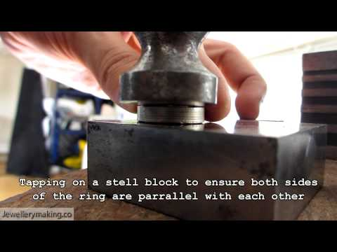 Hand making a sterling silver men's wedding band