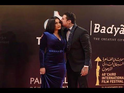 قبلة أحمد الفيشاوي لزوجته على السجادة الحمراء بافتتاح مهرجان القاهرة السينمائي